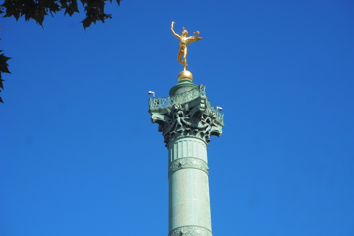Golden angel statue on top of Bastille Monument, Paris, France.