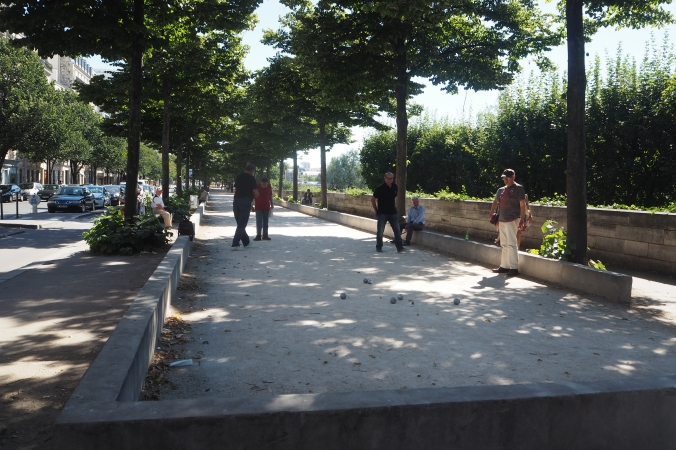 Playing Bocce by the Seine